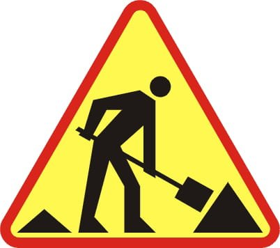 na zdjęciu: znak drogowy ostrzegający o robotach na drodze